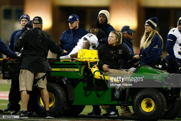 Mikee Hayes of the Akron Zips reacts as he is carted off the field with a injury against the Miami Ohio Redhawks during the first half at Yager...