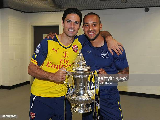Mikel Arteta and Theo Walcott of Arsenal in the changingroom with the FA Cup Trophy after the match between Arsenal and Aston Villa in the FA Cup...