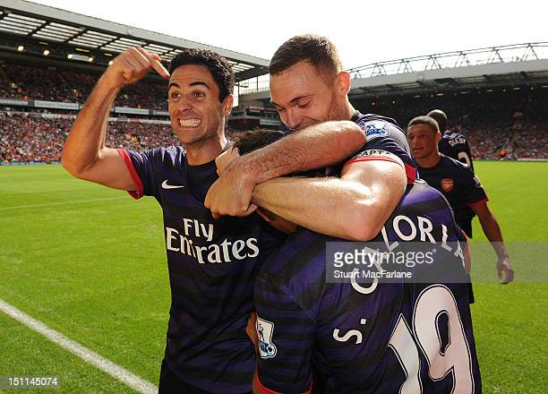 Mikel Arteta celebrates the 2nd Arsenal goal scored by Santi Cazorla during the Barclays Premier League match between Liverpool and Arsenal at...