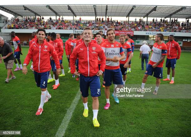 Mikel Arteta Jack Wilshere and Mathieu Flamini of Arsenal during a training session on July 30 2014 in Bad Waltersdorf Austria