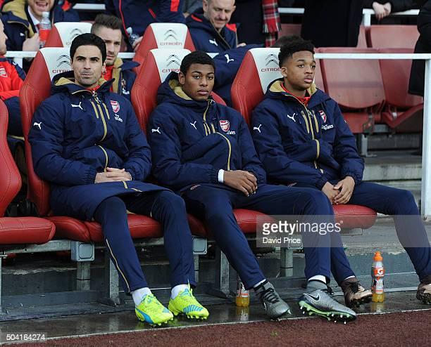 Mikel Arteta Jeff ReineAdelaide and Chris Willock of Arsenal on the bench before the FA Cup 3rd Round match between Arsenal and Sunderland at...