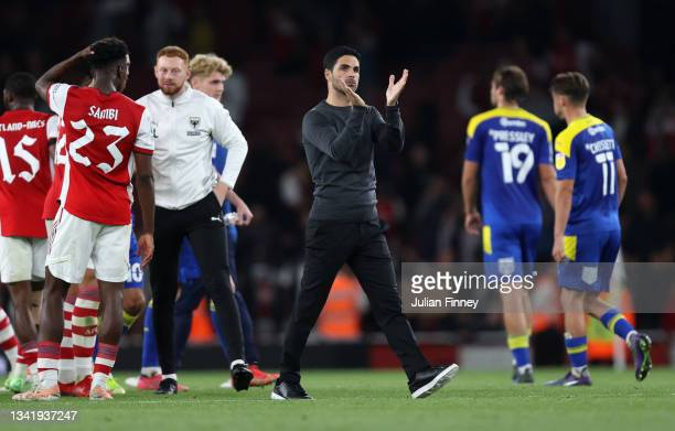 Mikel Arteta, Manager of Arsenal applauds fans after his teams victory in the Carabao Cup Third Round match between Arsenal and AFC Wimbledon at...