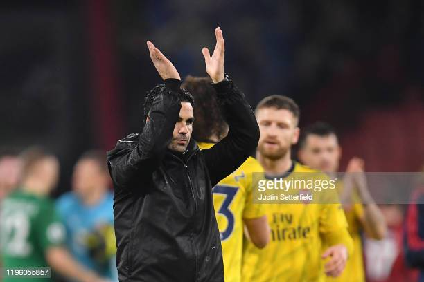 Mikel Arteta Manager of Arsenal applauds fans following his team's draw in the Premier League match between AFC Bournemouth and Arsenal FC at...