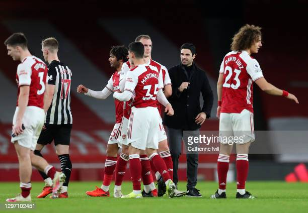 Mikel Arteta, Manager of Arsenal celebrate with Mohamed Elneny, Rob Holding, Gabriel Martinelli and David Luiz of Arsenal following their side's...