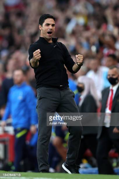 Mikel Arteta, Manager of Arsenal celebrates their side's victory after the Premier League match between Arsenal and Tottenham Hotspur at Emirates...