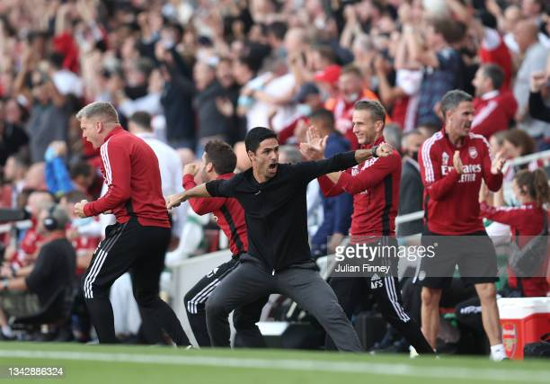Mikel Arteta manager of Arsenal celebrates their teams second goal during the Premier League match between Arsenal and Tottenham Hotspur at Emirates...