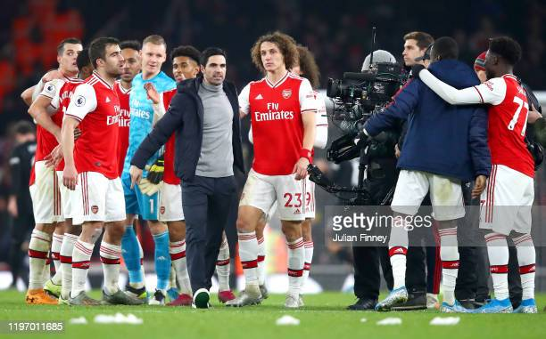 Mikel Arteta Manager of Arsenal celebrates victory with David Luiz after the Premier League match between Arsenal FC and Manchester United at...