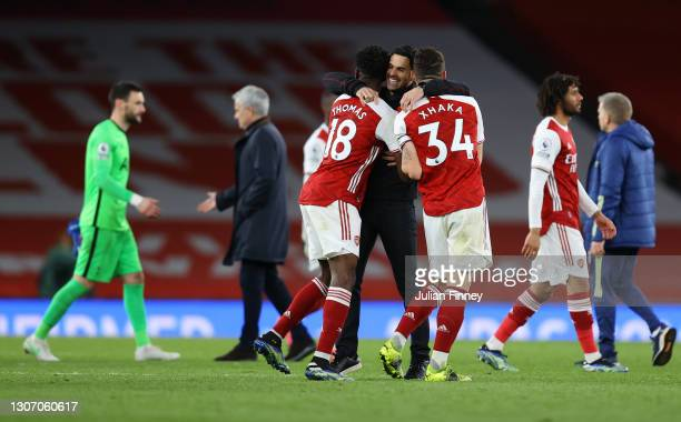Mikel Arteta, Manager of Arsenal celebrates victory with Thomas Partey and Granit Xhaka of Arsenal following the Premier League match between Arsenal...