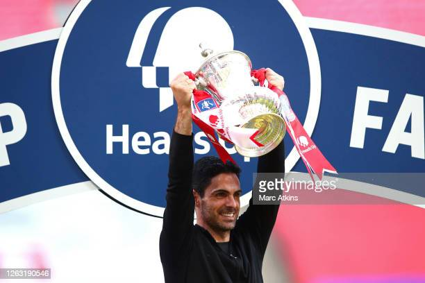 Mikel Arteta, Manager of Arsenal celebrates with the Heads Up Emirates FA Cup Trophy following his team's victory in the FA Cup Final match between...