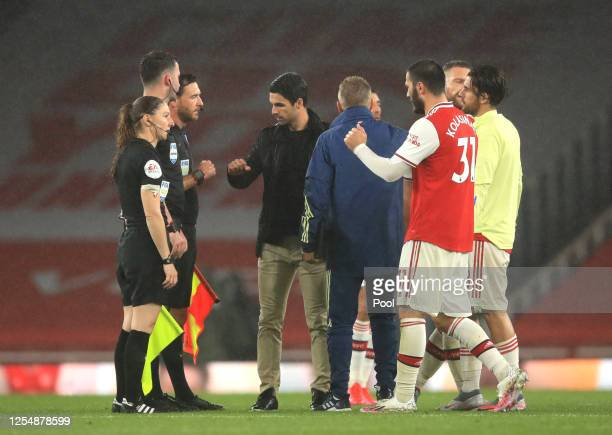Mikel Arteta Manager of Arsenal fist bumps with Match Officials following the Premier League match between Arsenal FC and Leicester City at Emirates...