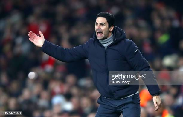 Mikel Arteta Manager of Arsenal gives his team instructions during the Premier League match between Arsenal FC and Manchester United at Emirates...