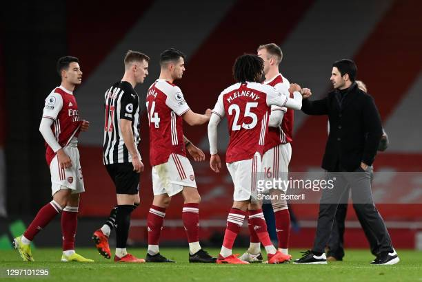 Mikel Arteta, Manager of Arsenal, Granit Xhaka and Mohamed Elneny of Arsenal celebrate following their side's victory in during the Premier League...