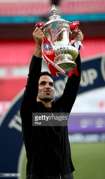 Mikel Arteta, Manager of Arsenal lifts the FA Cup Trophy after his teams victory in the Heads Up FA Cup Final match between Arsenal and Chelsea at...