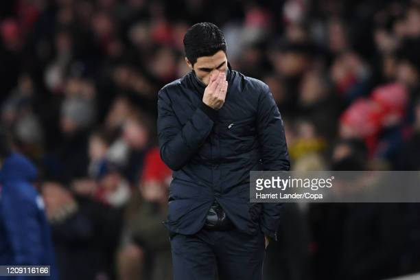 Mikel Arteta Manager of Arsenal looks dejected after his team concede a second goal during the UEFA Europa League round of 32 second leg match...