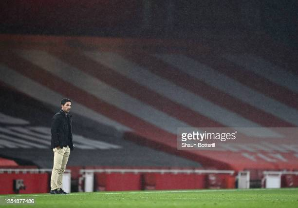 Mikel Arteta Manager of Arsenal looks on during the Premier League match between Arsenal FC and Leicester City at Emirates Stadium on July 07 2020 in...