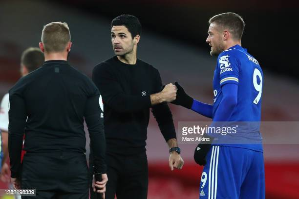 Mikel Arteta Manager of Arsenal shakes hands with Jamie Vardy of Leicester City following the Premier League match between Arsenal and Leicester City...