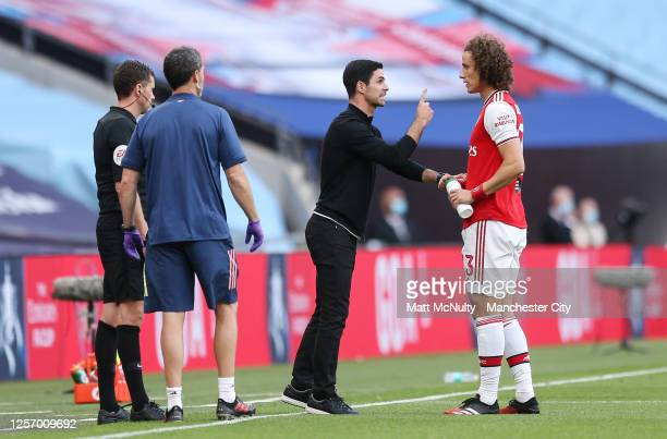Mikel Arteta manager of Arsenal speaks with David Luiz during the FA Cup Semi Final match between Arsenal and Manchester City at Wembley Stadium on...