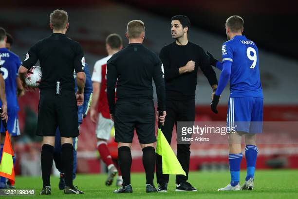 Mikel Arteta Manager of Arsenal speaks with referee Crag Pawson and his assistant referees following the Premier League match between Arsenal and...