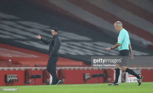 Mikel Arteta Manager of Arsenal talks to referee Martin Atkinson during the Premier League match between Arsenal and Aston Villa at Emirates Stadium...