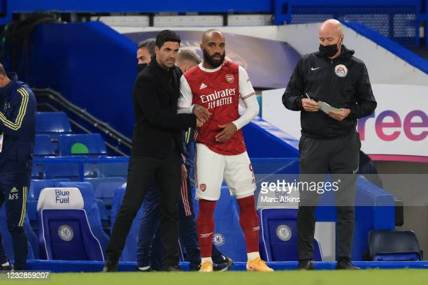 Mikel Arteta manager of Arsenal with Alexandre Lacazette during the Premier League match between Chelsea and Arsenal at Stamford Bridge on May 12,...