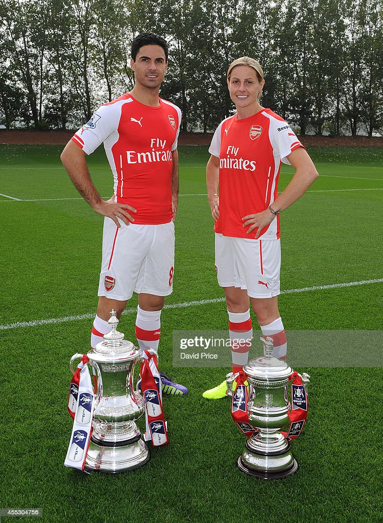 Mikel Arteta of Arsenal and Kelly Smith of Arsenal Ladies during the 1st team squad photograph at London Colney on September 11, 2014 in St Albans, England.