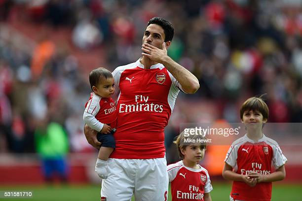Mikel Arteta of Arsenal applauds supporters after the Barclays Premier League match between Arsenal and Aston Villa at Emirates Stadium on May 15...