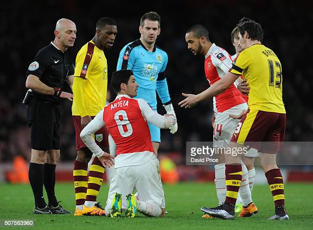 Mikel Arteta of Arsenal argues with Joey Barton of Burnley during the match between Arsenal and Burnley in the FA Cup 4th round at Emirates Stadium...