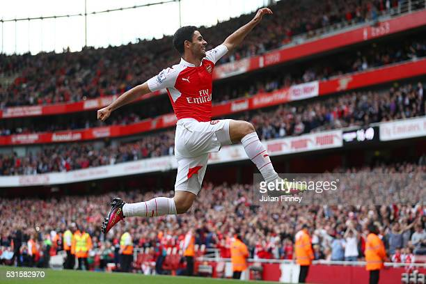 Mikel Arteta of Arsenal celebrate his team's fourth goal scored own goal by Mark Bunn of Aston Villa during the Barclays Premier League match between...