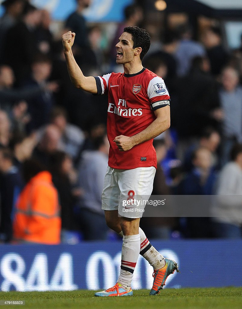 Mikel Arteta of Arsenal celebrates after the match between Tottenham Hotspur and Arsenal in the Barclays Premier League at White Hart Lane on March 16, 2014 in London, England.