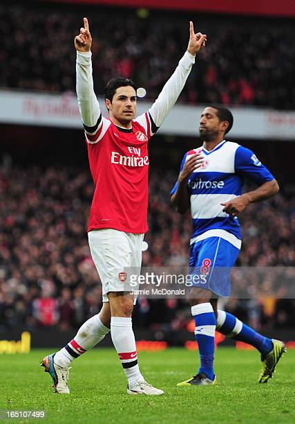 Mikel Arteta of Arsenal celebrates as he scores their fourth goal from the penalty spot during the Barclays Premier League match between Arsenal and...