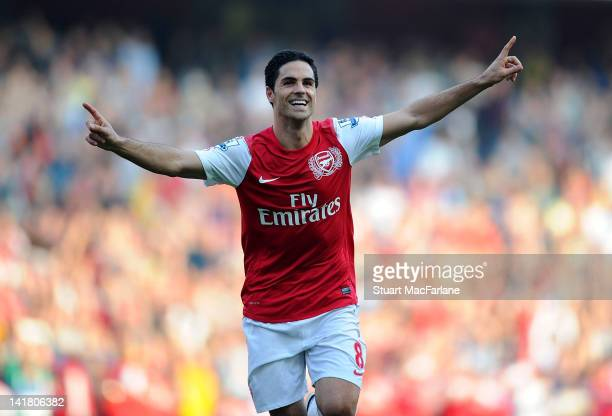 Mikel Arteta of Arsenal celebrates scoring his team's third goal during the Barclays Premier League match between Arsenal and Aston Villa at Emirates...