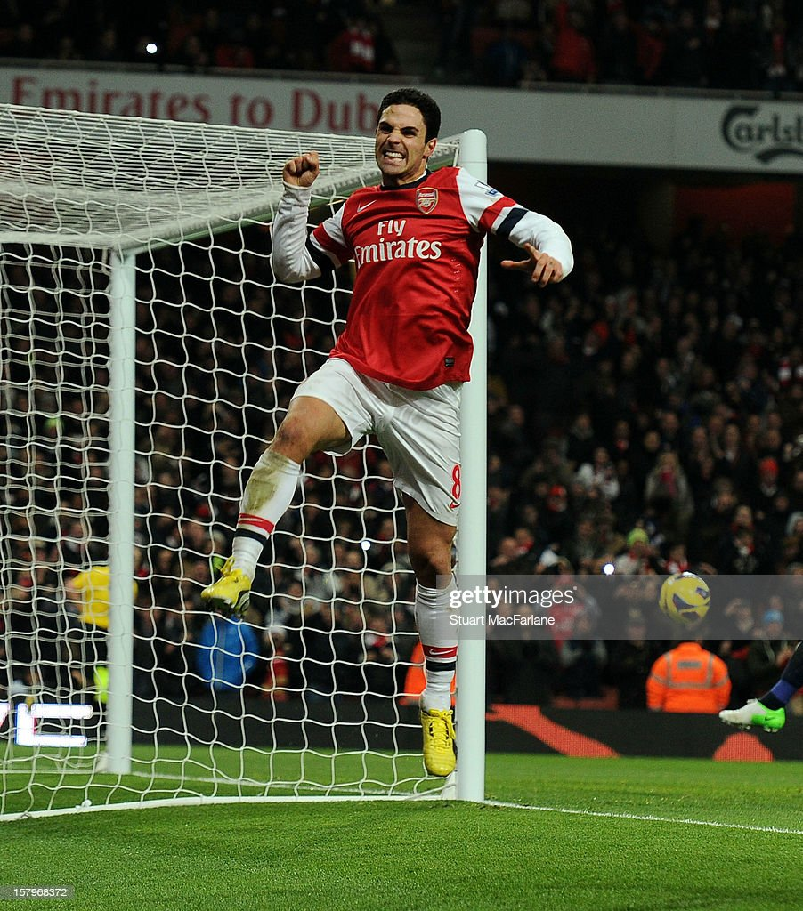 Mikel Arteta of Arsenal celebrates scoring the 2nd goal from the penalty spot during the Barclays Premier League match between Arsenal and West Bromwich Albion, at Emirates Stadium on December 08, 2012 in London, England.