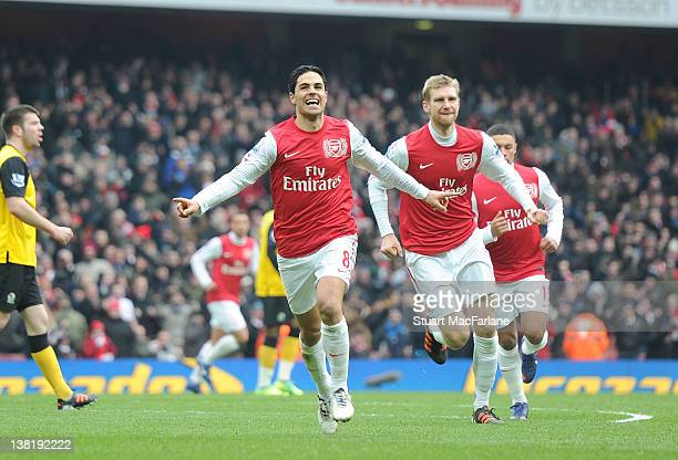 Mikel Arteta of Arsenal celebrates scoring the 5th Arsenal goal during the Barclays Premier League match between Arsenal and Blackburn Rovers at...