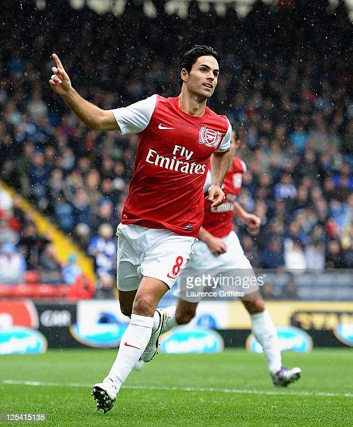 Mikel Arteta of Arsenal celebrates the second goal during the Barclays Premier League match between Blackburn Rovers and Arsenal at Ewood Park on...