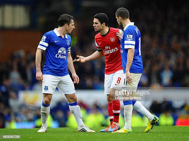 Mikel Arteta of Arsenal clashes with Leighton Baines of Everton during the Barclays Premier League match between Everton and Arsenal at Goodison Park...