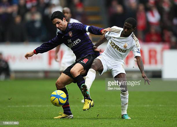Mikel Arteta of Arsenal holds off Nathan Dyer of Swansea City during the FA Cup with Budweiser Third Round match between Swansea City and Arsenal at...