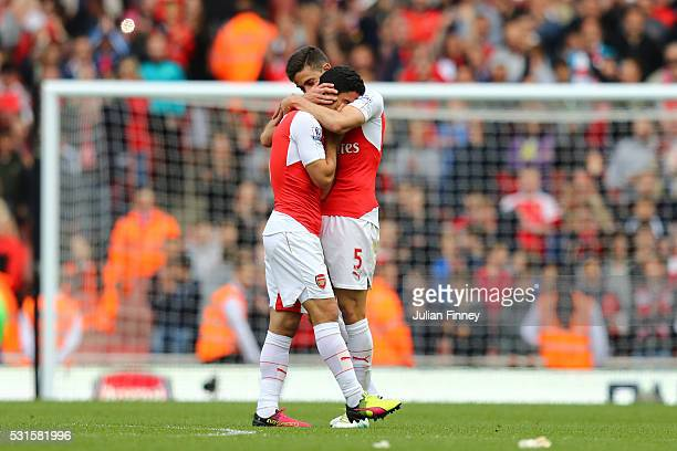 Mikel Arteta of Arsenal hugs with Gabriel after the Barclays Premier League match between Arsenal and Aston Villa at Emirates Stadium on May 15 2016...
