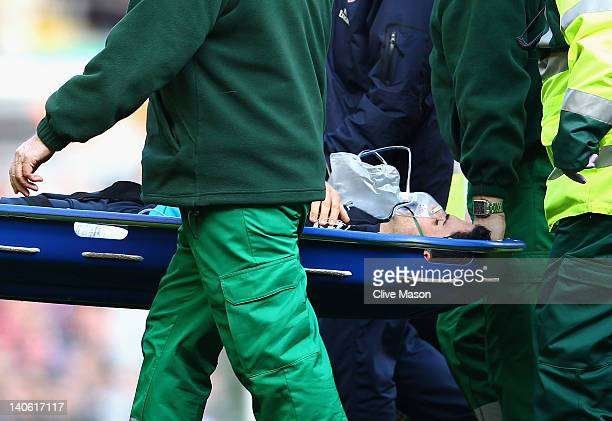 Mikel Arteta of Arsenal is carried off the pitch on a stretcher injured during the Barclays Premier League match between Liverpool and Arsenal at...