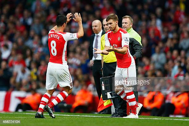 Mikel Arteta of Arsenal is substituted for Aaron Ramsey of Arsenal during the Barclays Premier League match between Arsenal and Burnley at Emirates...