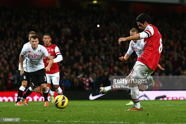 Mikel Arteta of Arsenal kicks a penalty during the Barclays Premier League match between Arsenal and Fulham at Emirates Stadium on November 10 2012...
