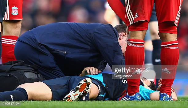 Mikel Arteta of Arsenal lies on the pitch injured during the Barclays Premier League match between Liverpool and Arsenal at Anfield on March 3 2012...