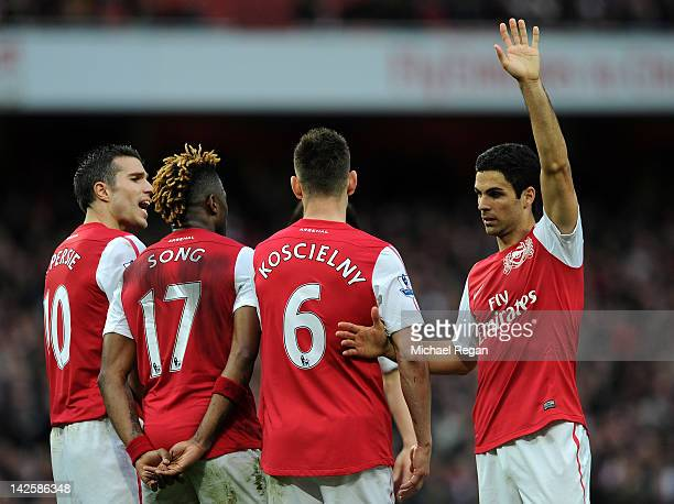 Mikel Arteta of Arsenal lines up the wall during the Barclays Premier League match between Arsenal and Manchester City at Emirates Stadium on April 8...