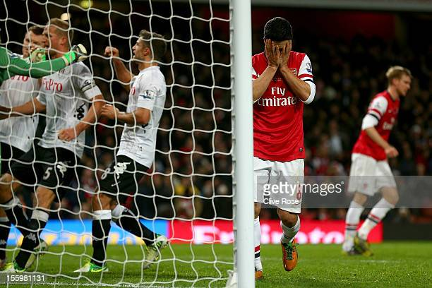 Mikel Arteta of Arsenal reacts after missing a match winning penalty kick during the Barclays Premier League match between Arsenal and Fulham at...