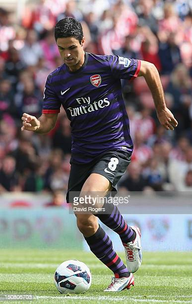 Mikel Arteta of Arsenal runs with the ball during the Barclays Premier League match between Stoke City and Arsenal at the Britannia Stadium on August...