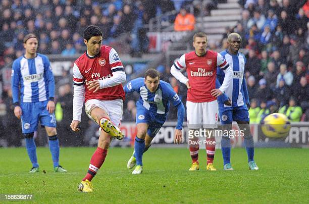 Mikel Arteta of Arsenal scores from the penalty spot during the Barclays Premier League match between Wigan Athletic and Arsenal at DW Stadium on...