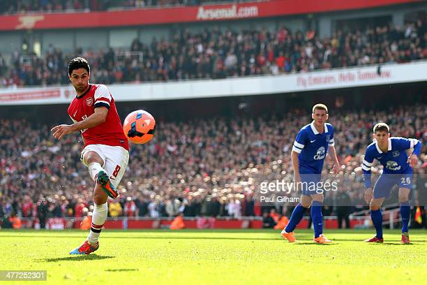 Mikel Arteta of Arsenal scores his team's second goal from the penalty spot during the FA Cup QuarterFinal match between Arsenal and Everton at...