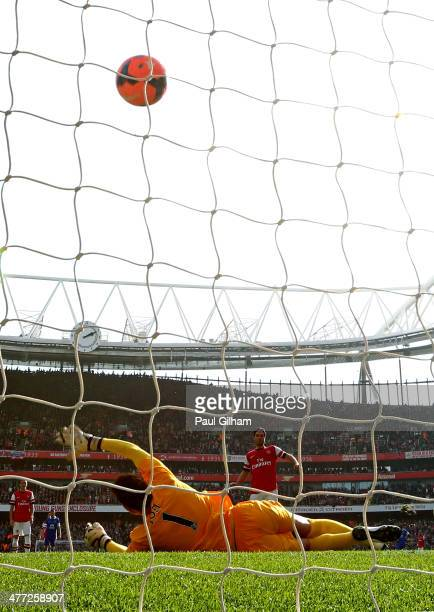 Mikel Arteta of Arsenal scores his team's second goal from the penalty spot past goalkeeper Joel Robles of Everton during the FA Cup QuarterFinal...