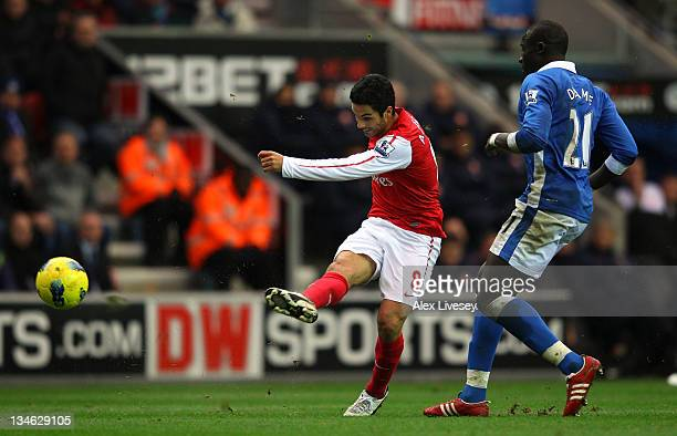 Mikel Arteta of Arsenal scores the opening goal during the Barclays Premier League match between Wigan Athletic and Arsenal at the DW Stadium on...