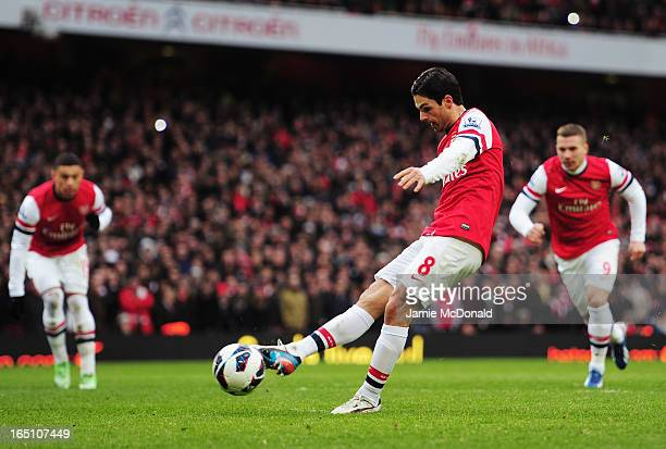Mikel Arteta of Arsenal scores their fourth goal from the penalty spot during the Barclays Premier League match between Arsenal and Reading at...