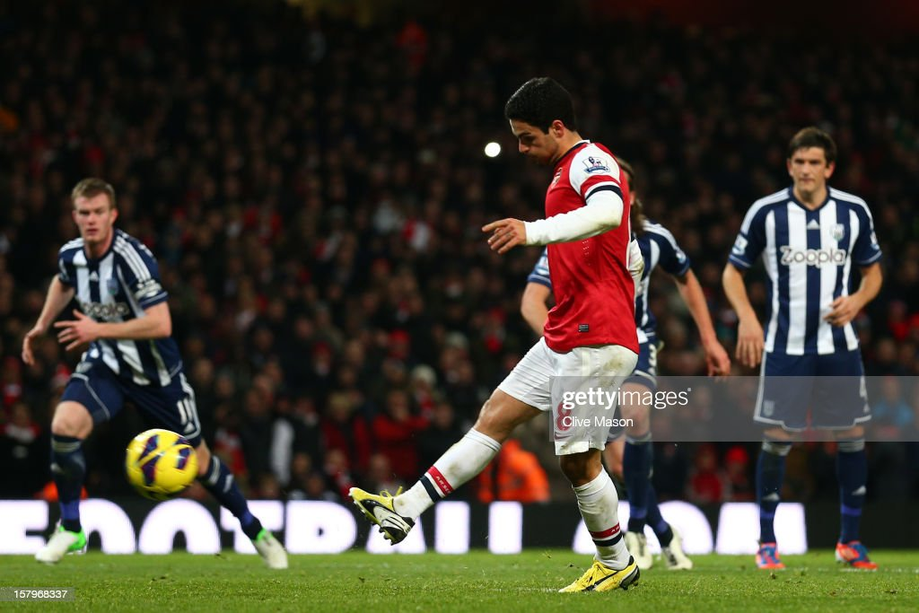 Mikel Arteta of Arsenal scores their second goal from the penalty spot during the Barclays Premier League match between Arsenal and West Bromwich Albion at Emirates Stadium on December 8, 2012 in London, England.